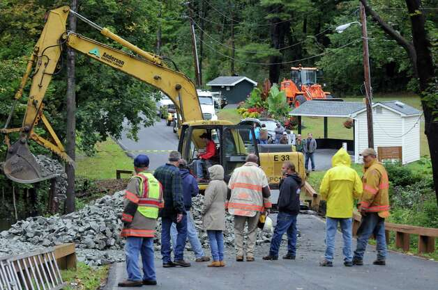 Crews rebuild a road washed away during flooding on Terrace Drive the entrance off of Rout 7 to Terrace Haven  Community a mobile home park on Wednesday Sept. 30, 2015 in Brunswick , N.Y.  (Michael P. Farrell/Times Union) Photo: Michael P. Farrell / 10033570A