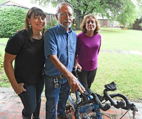 The Strope family, Sara, left, Harold and Miriam stand near Harold's bike at the Albany Academy for Girls Sept. 30, 2015 in Albany, N.Y. On Thursday, October 1st, Sara Strope and her father will embark on a four-day, 200-mile bike ride, departing from Delmar. In 1995, during Sara's senior year at Albany Academy for Girls, her father had lifesaving surgery at Mass General in Boston - a heart transplant. Now they are embarking on this ride together celebrate the 20th anniversary of his transplant. They will be biking the route that Harold Strope took 20 years ago to receive his heart. They will be gathering at 9:00am Thursday at the Seville Bike Shop in Delmar to leave at 9:30. At least a dozen community members will be gathering to send them off.   (Skip Dickstein/Times Union) Photo: SKIP DICKSTEIN / 10033553A