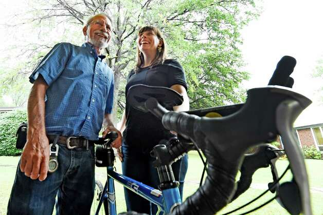 Harold and Sara Strope stand near Harold's bike at the Albany Academy for Girls Sept. 30, 2015 in Albany, N.Y. On Thursday, October 1st, Sara Strope and her father will embark on a four-day, 200-mile bike ride, departing from Delmar. In 1995, during Sara's senior year at Albany Academy for Girls, her father had lifesaving surgery at Mass General in Boston - a heart transplant. Now they are embarking on this ride together celebrate the 20th anniversary of his transplant. They will be biking the route that Harold Strope took 20 years ago to receive his heart. They will be gathering at 9:00am Thursday at the Seville Bike Shop in Delmar to leave at 9:30. At least a dozen community members will be gathering to send them off.   (Skip Dickstein/Times Union) Photo: SKIP DICKSTEIN / 10033553A