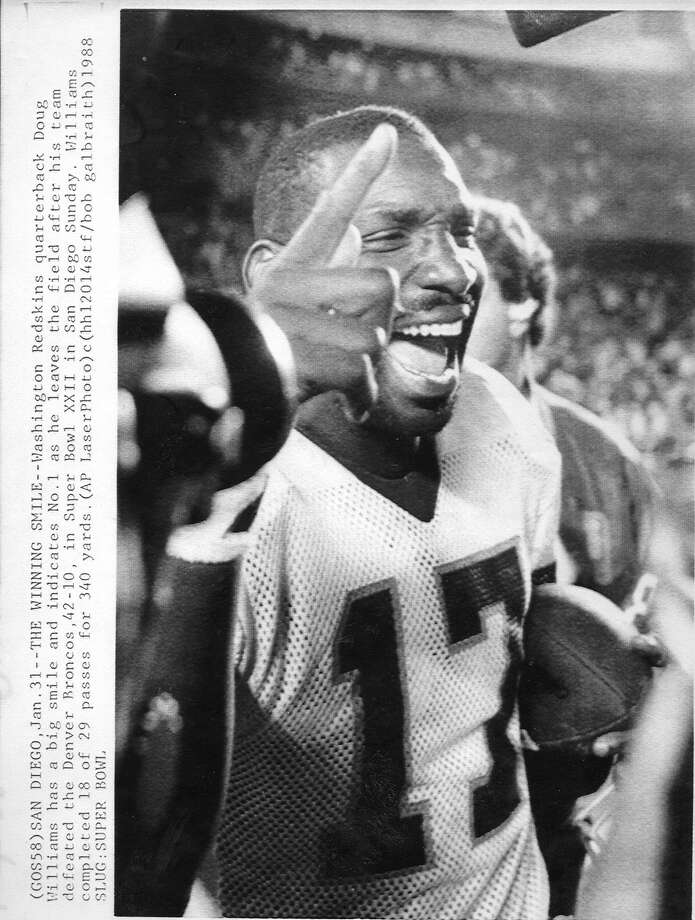 Washington Redskins quarterback Doug Williams would be named MVP of Super Bowl XXII after defeating the Denver Broncos 42-10 AP photo Photo ran 02/01/1988,  D.1