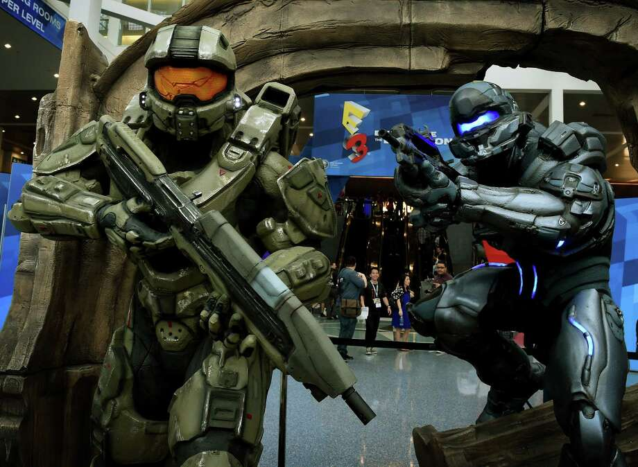 "Action figures from the game ""Halo"" welcome visitors on the opening day of the Electronic Entertainment Expo, known as E3 at the Convention Center in Los Angeles, California on June 16, 2015. Photo: MARK RALSTON, Getty Images / AFP"
