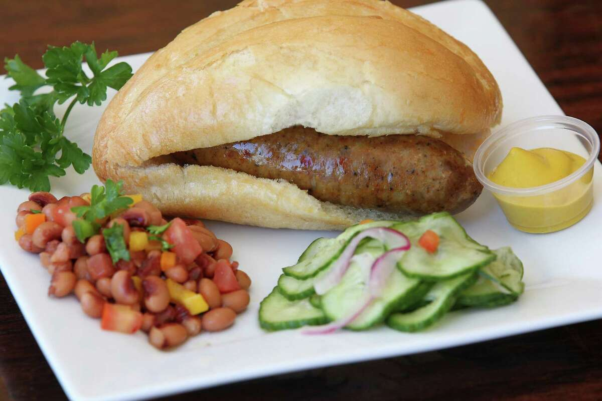 Dresden Cafe serves Hungarian sausage with black eyed pea salad and German cucumber salad.The restaurant has announced that it's now closed.