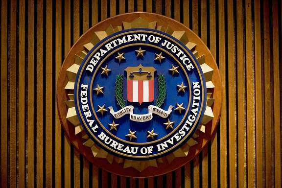 "(FILES) This August 3, 2007 file photo shows a crest of the Federal Bureau of Investigation(FBI) inside the J. Edgar Hoover FBI Building in Washington, DC.  US authorities have seized the website of Sharebeast, said to be the largest illegal music-sharing operation based on the United States. Visitors to the Sharebeast website and that of an affiliated domain, albumjams.com, saw a message from the Justice Department and FBI saying the sites had been seized in an anti-piracy operation. The Recording Industry Association of America, which represents major music labels, welcomed the shutdown, saying the network was hosting more than 100,000 files in violation of copyright. ""This is a huge win for the music community and legitimate music services,"" RIAA chairman and chief executive Cary Sherman said in a statement September 11. 2015.  AFP PHOTO/MANDEL NGAN / FILESMANDEL NGAN/AFP/Getty Images"
