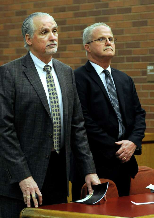 Brookfield's former school finance director Art Colley, right, appears in Superior Court in Danbury, Conn., Wednesday morning, March 25, 2015, alongside his attorney, Eugene Riccio. Colley and his former assistant Elizabeth Kerekes are accused of stealing thousands of dollars from the district. Photo: Carol Kaliff / Carol Kaliff / The News-Times