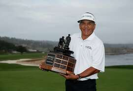 PEBBLE BEACH, CA - SEPTEMBER 27:  Esteban Toledo of Mexico holds the trophy after winning the Nature Valley First Tee Open at the Pebble Beach Golf Links on September 27, 2015 in Pebble Beach, California.  (Photo by Ezra Shaw/Getty Images)