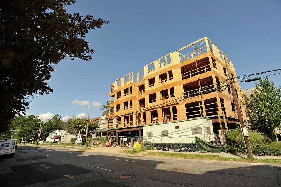 This photo, taken in August, shows construction underway on an apartment building at 545 Bedford Street in Stamford. Even amid an ongoing residential building boom across Fairfield County, permits for future construction rose 50 percent in the first seven months of the year. Photo: Jason Rearick / Hearst Connecticut Media / Stamford Advocate