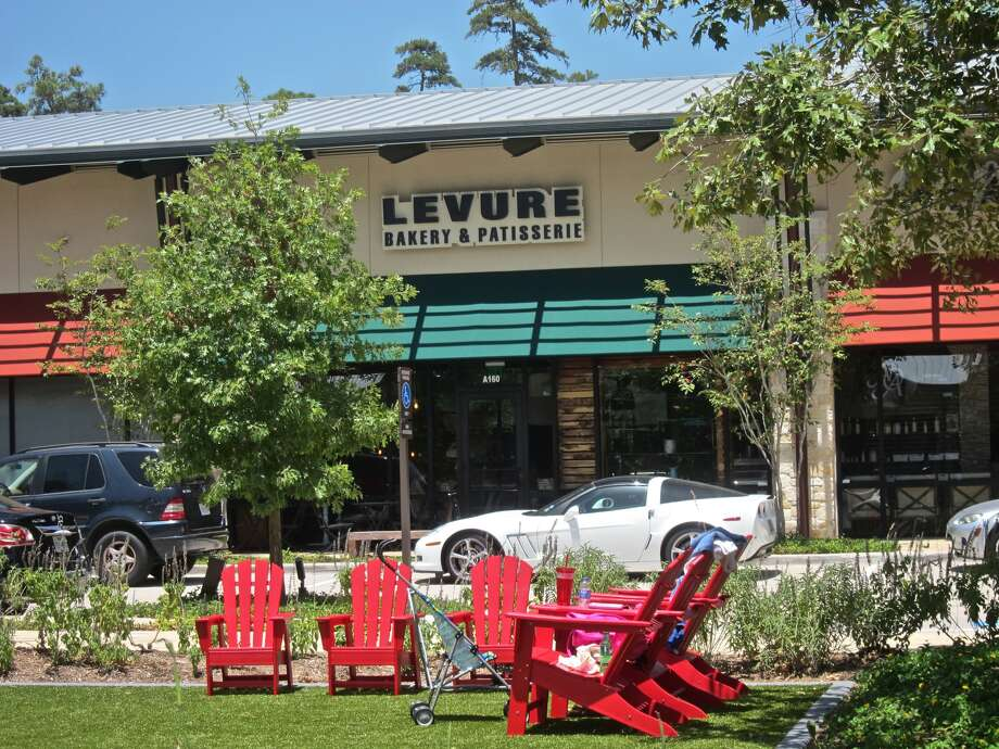 "Levure Bakery & Patisserie looks out on to an Astroturf ""Village Green"" in the Creekside Park Village Center. The address is Tomball; the look is pure The Woodlands."