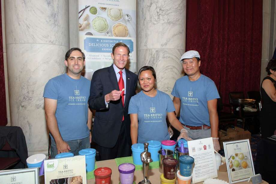 "Bridgeport-based Tea-rrific Ice Cream's Mario Leite (left), Sen. Richard Blumenthal, Souvannee Leite and an unidentified man at the ""Discover Connecticut"" expo on Capitol Hill in Washington, D.C. on Tuesday. Photo: John Klemmer/Contributed Photo / John Klemmer/Contributed Photo / Connecticut Post Contributed"