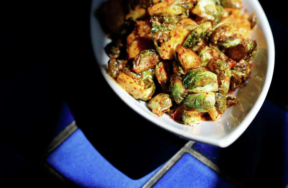Crispy shrimp with Brussels sprouts Photo: Kin Man Hui /San Antonio Express-News / ©2015 San Antonio Express-News