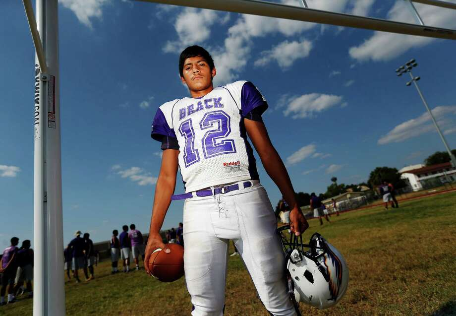 """Senior quarterback Antonio Lopez has continued an Eagles quarterback tradition, helping to groom the next group of signal-callers by working with the program's freshman team. """"I was there at one point,"""" he said. Photo: Kin Man Hui / San Antonio Express-News / ©2015 San Antonio Express-News"""