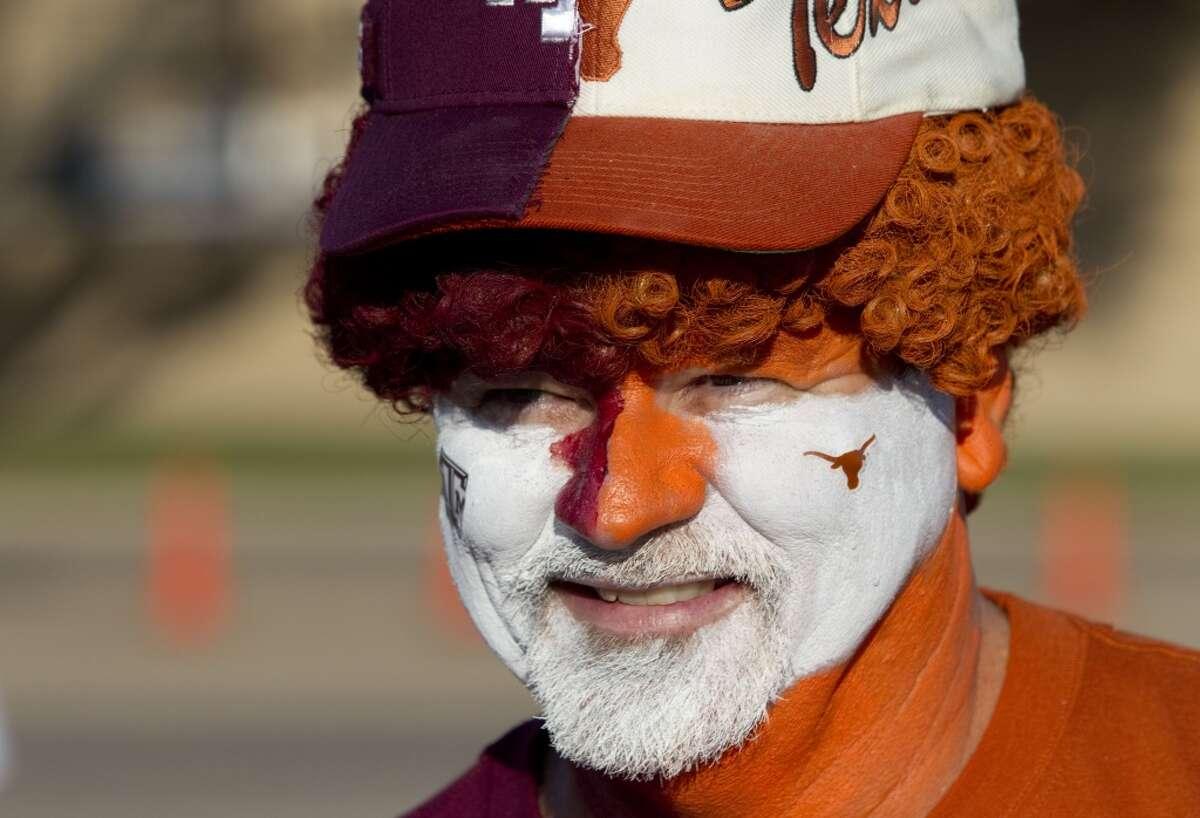 Dr. Geoffrey Garrett, Texas '76, and father of a Texas A&M student, of Shreveport, La., wears the colors of the two longtime rivals before the final scheduled meeting of the schools in an NCAA college football game at Kyle Field Thursday, Nov. 24, 2011, in College Station. ( Brett Coomer / Houston Chronicle )