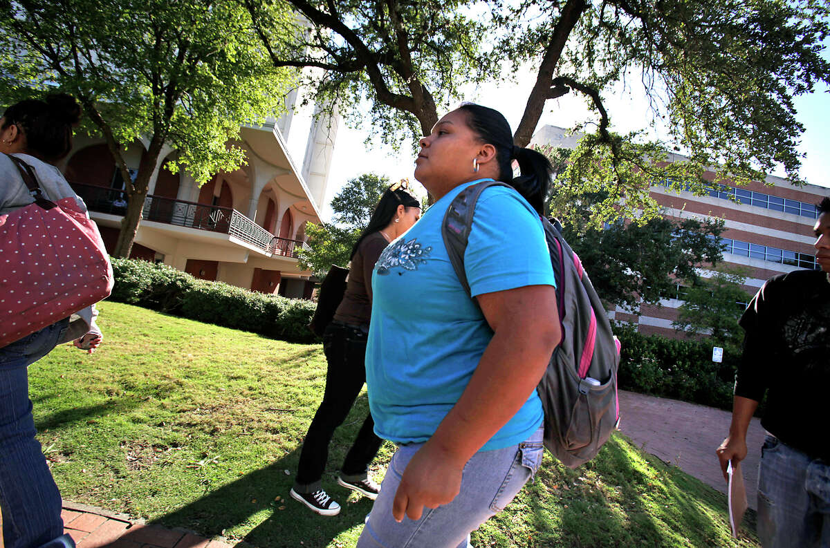 Monica Rodriguez, shown in 2010 as a San Antonio College student heading to another class. SAC is a Hispanic Serving Institution and this week received a five-year federal grant of $2.6 million to help Hispanic students graduate and transfer to four-year institutions.