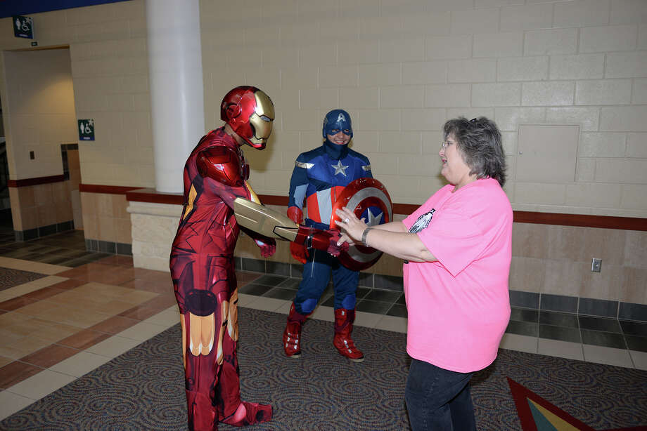 "The 2015 CFISD Health Expo, set for Oct. 10, will benefit the Health Organization of Physical Educators, which works to raise scholarship funds to support physical education and promote lifelong physical fitness. A health walk on the concourse with superheroes is part of this year's program. Above, Loretta Bourn, coordinator of elementary music and physical education, thanks""Iron Man"" and ""Captain America"" for assisting with the health walk on the concourse.           The 2015 CFISD Health Expo, set for Oct. 10, will benefit the Health Organization of Physical Educators, which works to raise scholarship funds to support physical education and promote lifelong physical fitness. A health walk on the concourse with superheroes is part of this year's program. Above, Loretta Bourn, coordinator of elementary music and physical education, thanks""Iron Man"" and ""Captain America"" for assisting with the health walk on the concourse. Photo: Cy-Fair ISD"