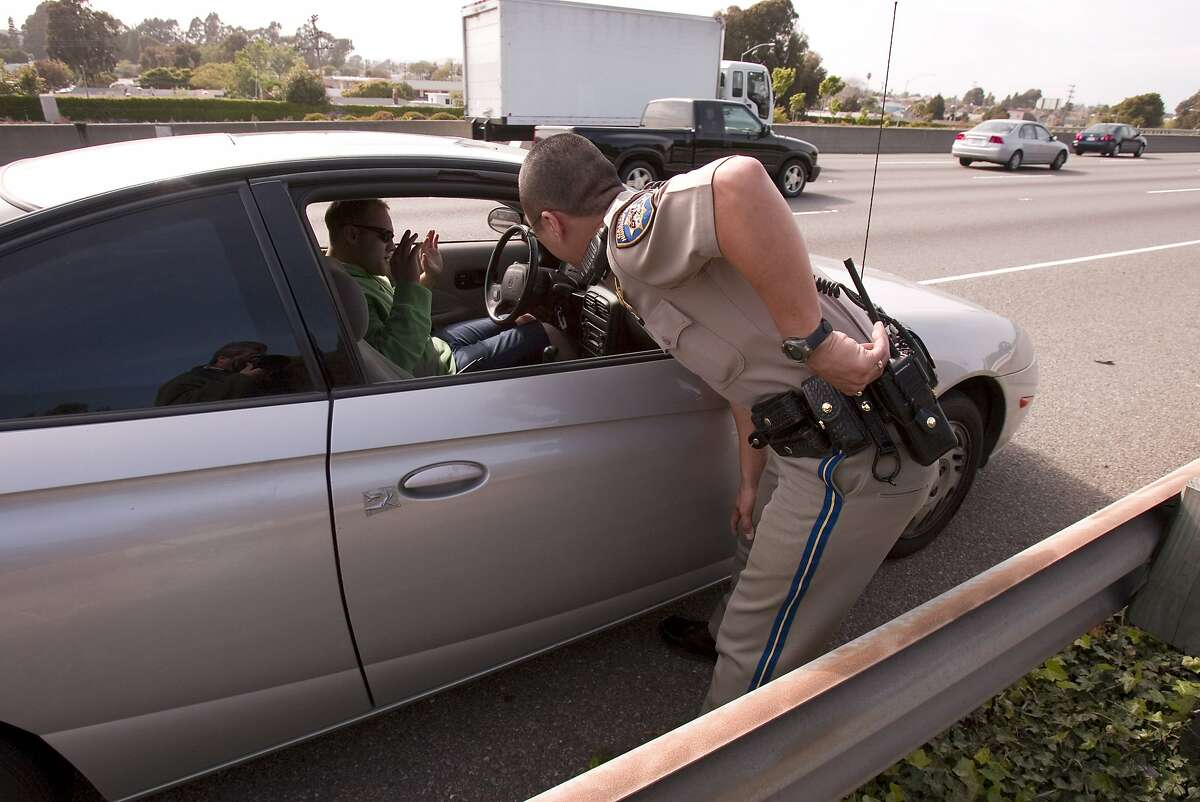 carpoollanes_0002_db.JPG CHP officer Tony Yao cites a carpool violator at the side of Highway 80 eastbound in Richmond, CA, on Wednesday, April, 25, 2007. photo taken: 4/25/07 Darryl Bush / The Chronicle ** (cq) Ran on: 08-19-2007 If you want to avoid a conversation that leads to a traffic ticket from the California Highway Patrol, dodge the speed traps. Ran on: 08-19-2007 If you want to avoid a conversation that leads to a traffic ticket from the California Highway Patrol, dodge the speed traps.
