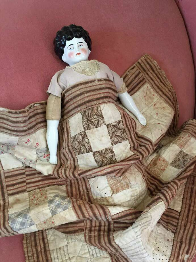 "Here's a traditional ""Block"" doll quilt made by Martha Jane Veal for her daughter Mantie. Martha died at the Dew House in 1907. DeWalt Heritage Center's free exhibit called ""Quilting Our Community Together"" will be open Sunday afternoons on Oct. 4, 11, 18 and 25. Photo: Fort Bend Museum"