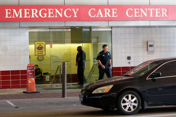 The Houston Police Department works a scene after an off-duty officer wounded a combative patient at St. Joseph Medical Center, Thursday, Aug. 27, 2015, in Houston. (Cody Duty / Houston Chronicle)