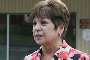 File - Colonie Supervisor Paula Mahan speaks to the media Tuesday, Sept. 22, 2015, outside the Handy Andy convenience store in Colonie, N.Y. Mahan presented her 2016 budget to the Town Board Wednesday. The $87.2 million plan is up 2.14 percent, or $1.8 million, but stays within the state tax cap. (Lori Van Buren / Times Union)