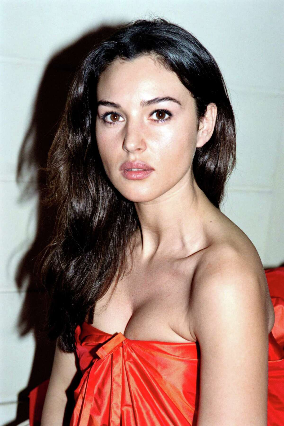 Monica Bellucci presents a new creation by Guy Laroche on Jan. 22, 1993 at age 28.
