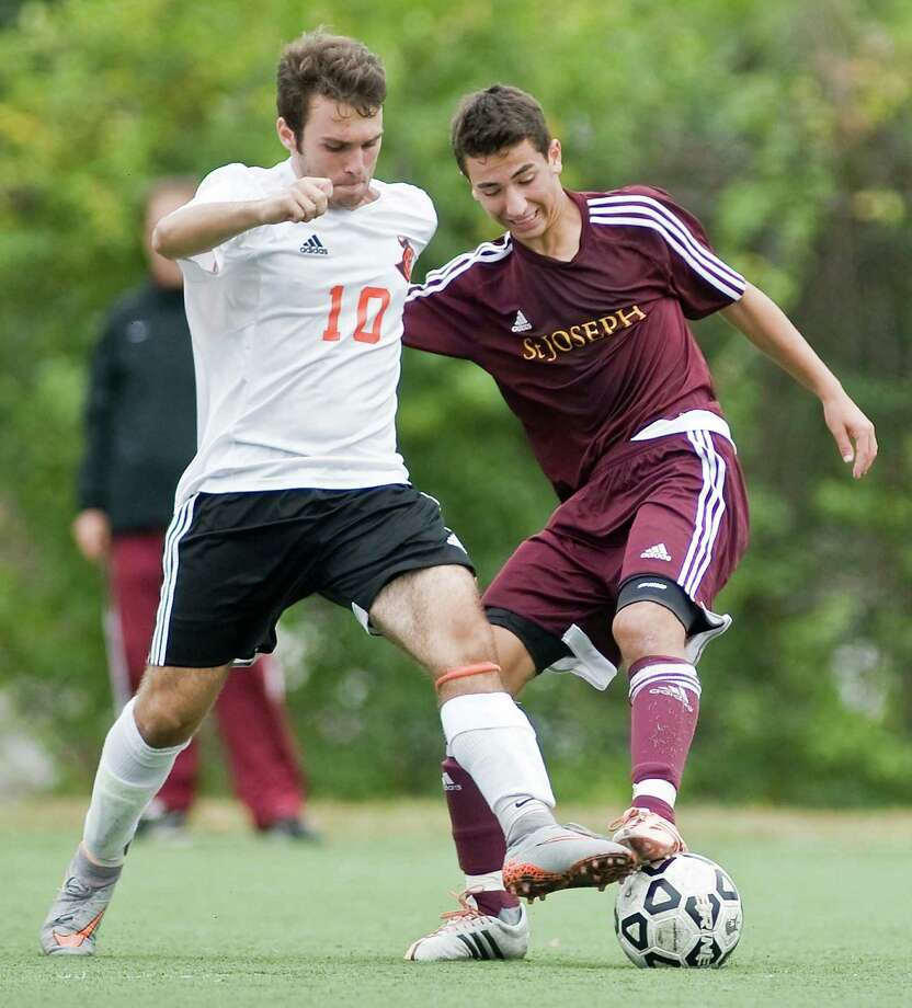Stamford High School's Victor Gjuraj and St. Joseph High School's Dante Alberti battle for the ball in a game at Stamford High School. Wednesday, Sept. 30, 2015 Photo: Scott Mullin / For Hearst Connecticut Media / The News-Times Freelance