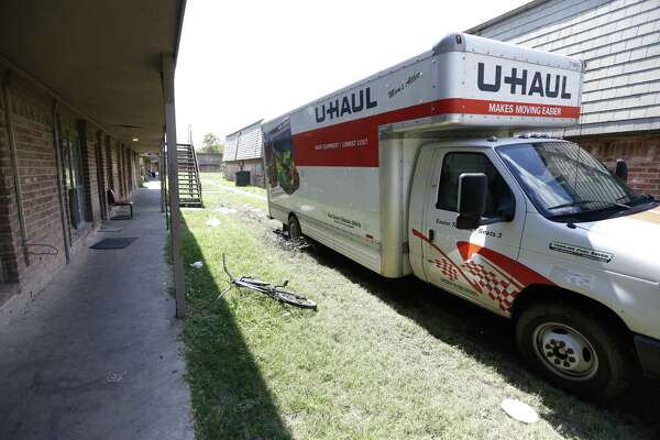 A U-Haul truck drives through mud to help move people out of their apartments Wednesday, Sept. 30, 2015, in Houston. The apartments at Crestmont Village are closing, and Sept. 30 is supposed to be the day that everyone has to vacate their apartments. Tenants were originally told Oct. 8 so people are very upset about it and don't have anywhere to go.