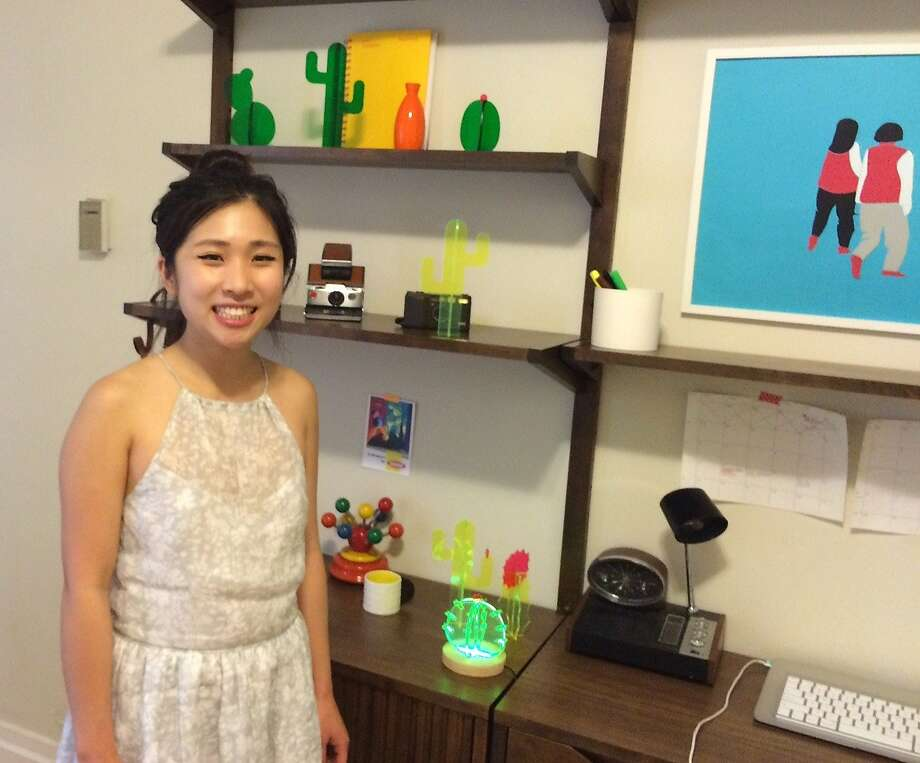Nobel Truong, a UC Berkeley business graduate student, has launched lines of furniture, home decor and light pieces designed to fill small living spaces -- like her Nob Hill basement apartment. Photo: Caille Millner, The Chronicle