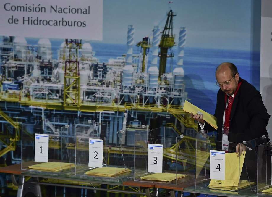 Eni representative Massimo Melandri takes part in Mexico's second auction of its offshore oil and gas fields. Eni won the most hotly contested block. Photo: Ronaldo Schemidt /AFP / Getty Images / RONALDO SCHEMIDT