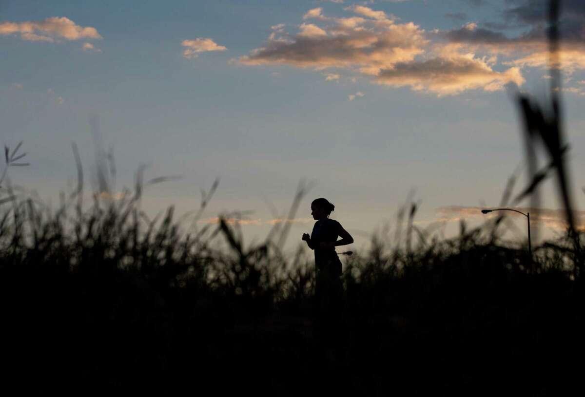 "Sarah Galt runs on the Kinder Footpath through Buffalo Bayou Park Thursday, Sept. 17, 2015, in Houston. Galt, who is from Atlanta, is in Houston for school. ""It's the perfect contrast, it feels like Houston, not concrete,"" she said. ( Jon Shapley / Houston Chronicle )"