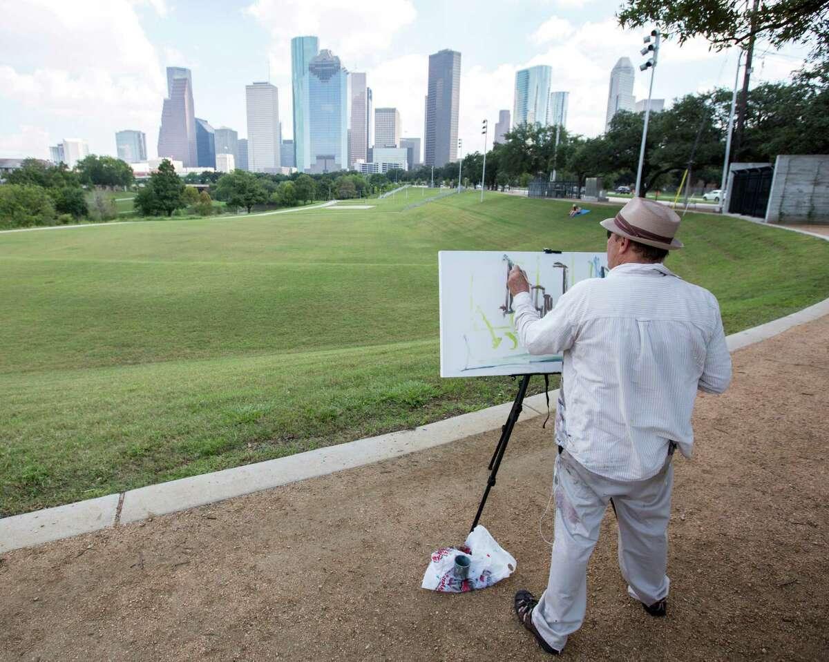 Arthur Deatly paints the city skyline from Eleanor Tinsley Park in the renewed Buffalo Bayou area.