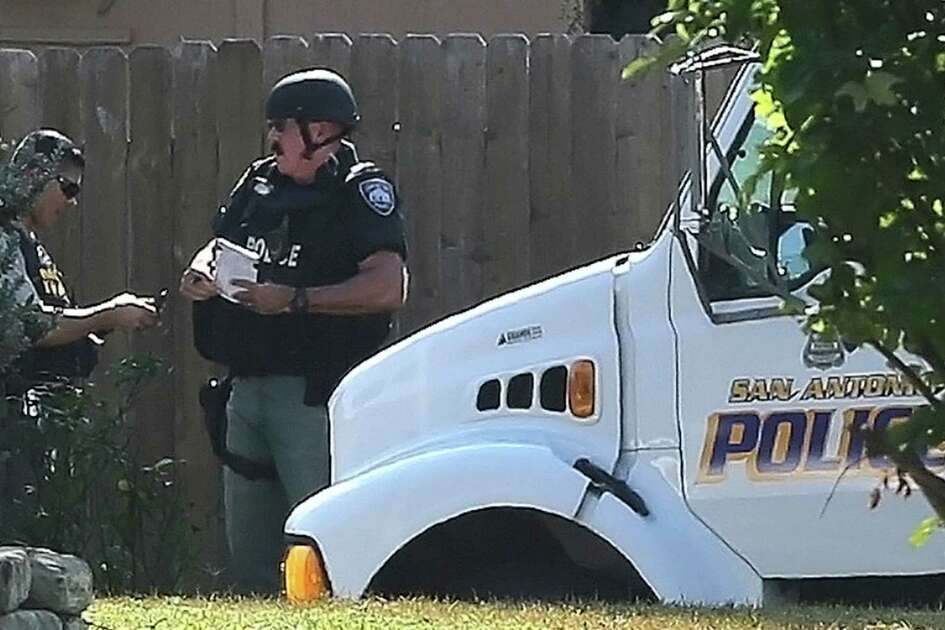 San Antonio police officers monitor the situation Wednesday September 30, 2015 during standoff on the 3000 block of Sage Hill. A person at a home in the area has allegedy been firing shots.