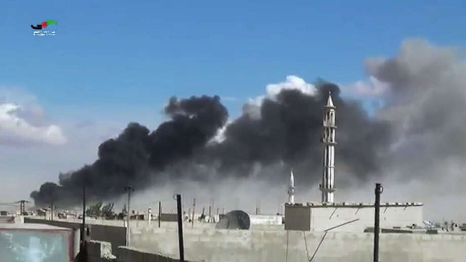 In this image made from video provided by Homs Media Centre, which has been verified and is consistent with other AP reporting, smoke rises after airstrikes by military jets in Talbiseh of the Homs province, western Syria, Wednesday, Sept. 30, 2015. Russian military jets carried out airstrikes in Syria for the first time on Wednesday, targeting what Moscow said were Islamic State positions. U.S. officials and others cast doubt on that claim, saying the Russians appeared to be attacking opposition groups fighting Syrian government forces. (Homs Media Centre via AP) ORG XMIT: CAIHK105 Photo: Uncredited / Homs Media Centre