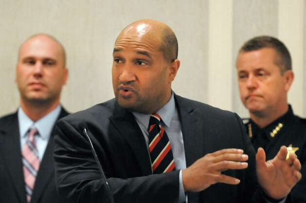 Albany County District Attorney David Soares, center, speaks during an event to kickoff Domestic Awareness Month on Wednesday, Sept. 30, 2015, at the Hilton Hotel in Albany, N.Y. Joining him are Albany Deputy Chief of Police Robert Sears, left, and Albany County Sheriff Craig Apple. The Third District Gender Fairness Committee put on the event to highlight the link between animal cruelty and domestic violence(Cindy Schultz / Times Union) Photo: Cindy Schultz / 00033544A