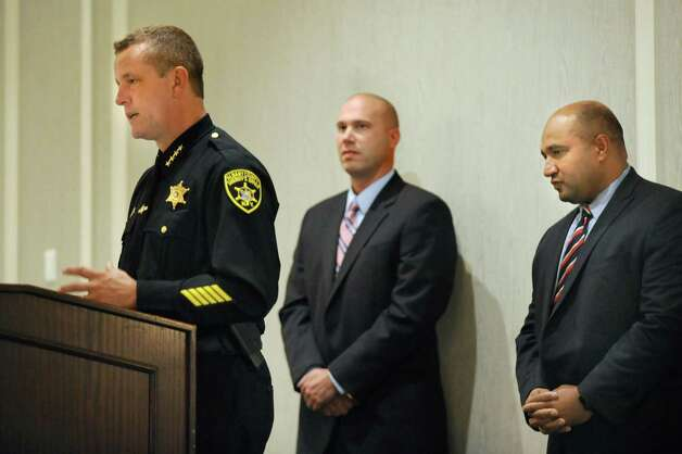 Albany County Sheriff Craig Apple, left, speaks during an event to kickoff Domestic Awareness Month on Wednesday, Sept. 30, 2015, at the Hilton Hotel in Albany, N.Y. Joining him are Albany Deputy Chief of Police Robert Sears, center, and Albany County District Attorney David Soares. The Third District Gender Fairness Committee put on the event to highlight the link between animal cruelty and domestic violence(Cindy Schultz / Times Union) Photo: Cindy Schultz / 00033544A