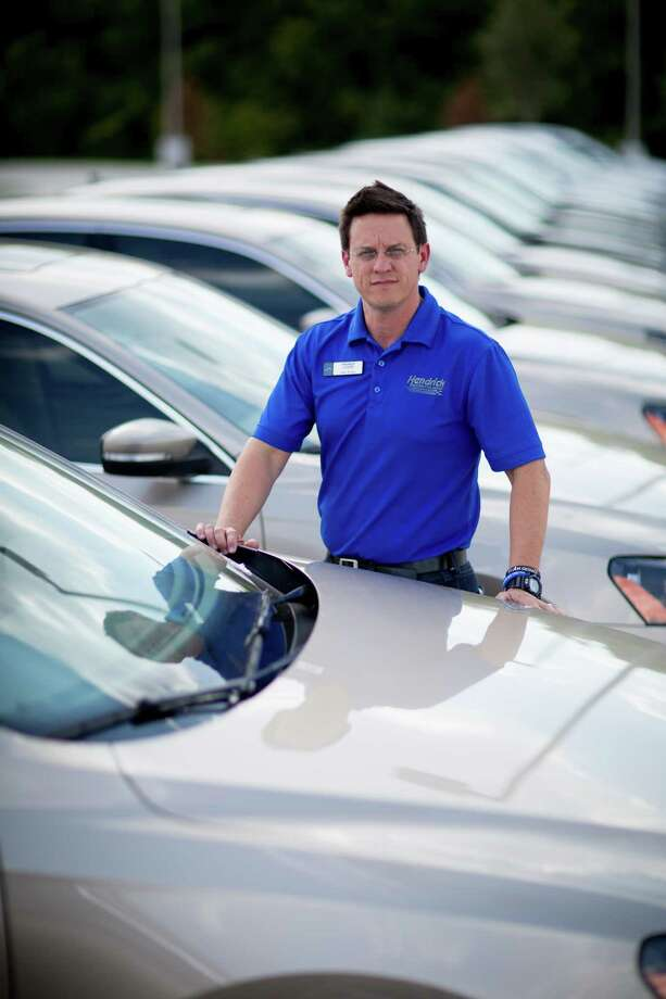 Alan Brown, general manager of Hendrick Volkswagen, with diesel Volkswagens set aside on the lot in Frisco, Texas, Sept. 28, 2015. The recent Volkswagen scandal has not only angered many of its customers, it is also threatening the prospects of hundreds of dealerships around the country that are anxious to learn how to fix diesel cars that intentionally thwart emissions tests. (Allison V. Smith/The New York Times) ORG XMIT: XNYT24 Photo: ALLISON V. SMITH / NYTNS