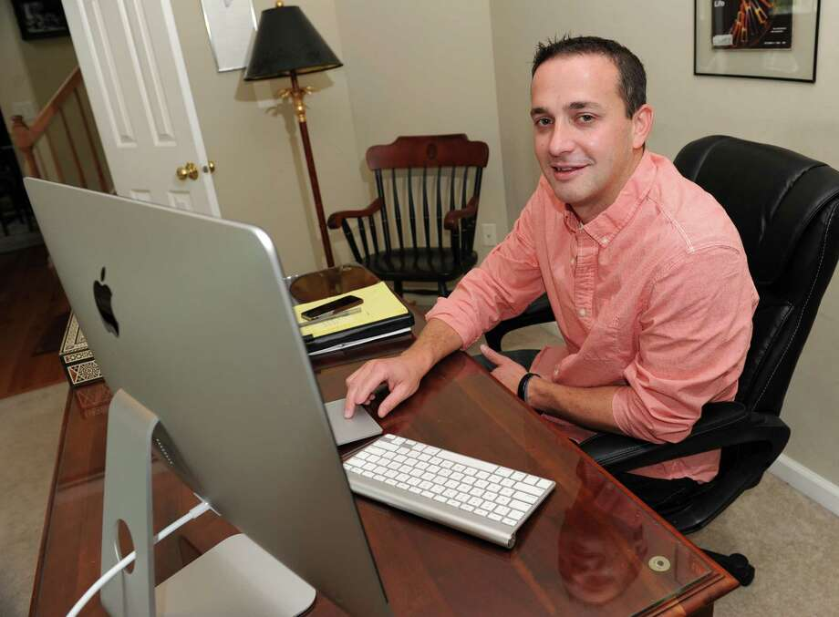 Dr. Michael Bibighaus sits at his home computer, on call, directing patients through various urgent scenarios on Wednesday, Sept. 30, 2015 in Clifton Park, N.Y. (Lori Van Buren / Times Union) Photo: Lori Van Buren / 00033540A