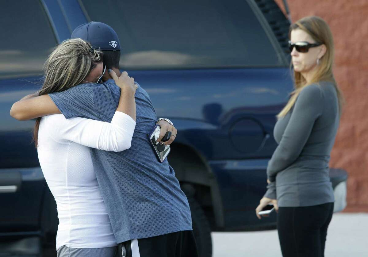 Dalton Herrera, 15, hugs his mom, Michelle Herrera, after she dropped him off with her ex-husband. She had accused the man of plotting to kill her.