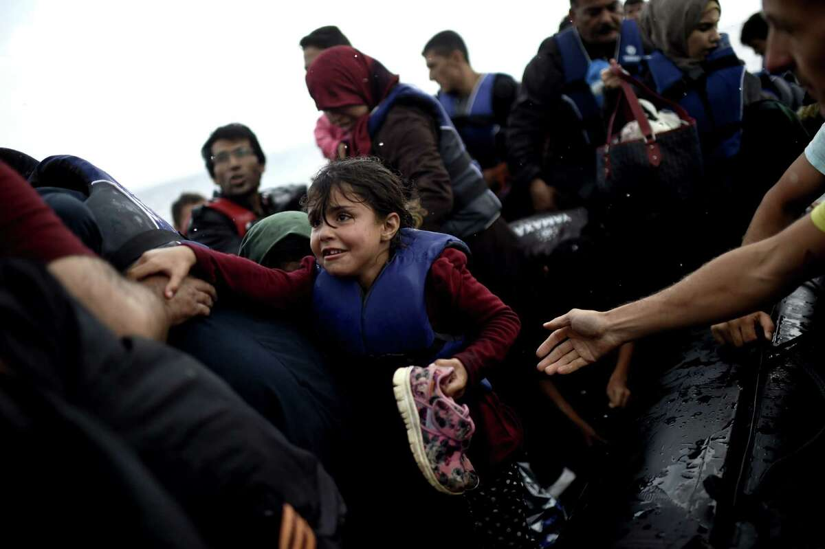 Refugees and migrants arrive in Greece after crossing the Aegean Sea from Turkey. A reader says any assistance for the refugees must be temporary.