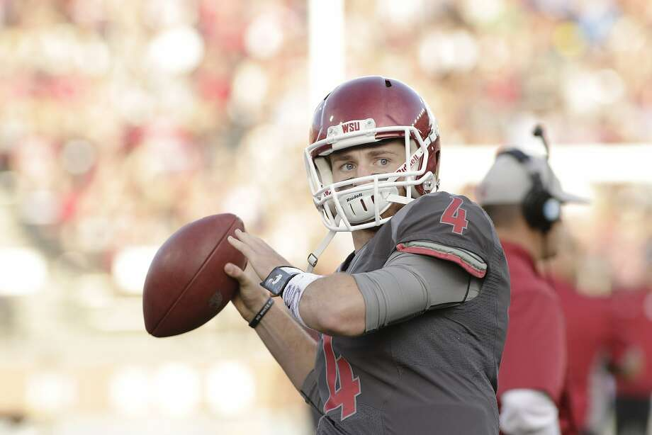 Washington State quarterback Luke Falk (4) warms up before an NCAA college football game against Wyoming, Saturday, Sept. 19, 2015, in Pullman, Wash. (AP Photo/Young Kwak) Photo: Young Kwak, Associated Press