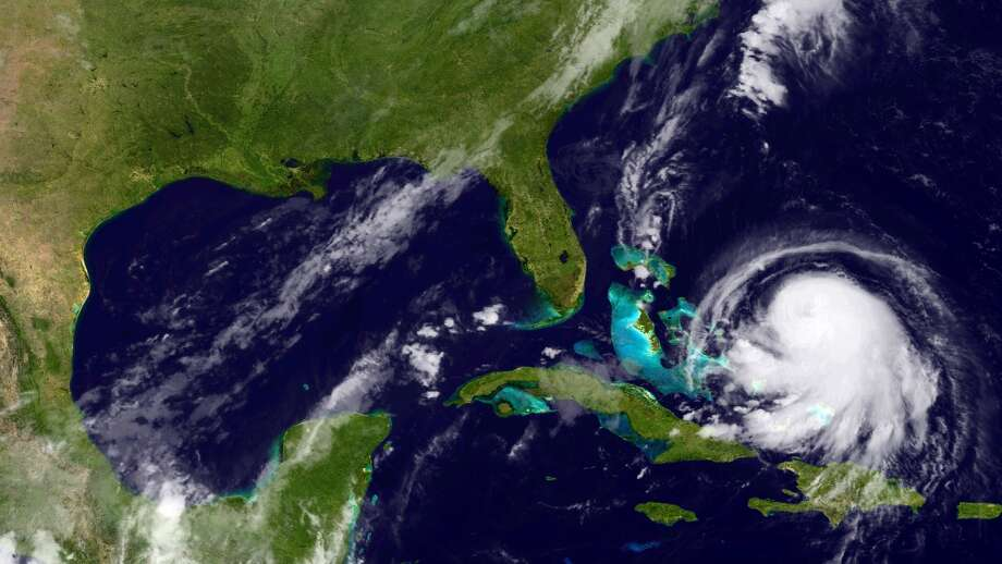 In this handout from the National Oceanic and Atmospheric Administration, Hurricane Joaquin is seen churning in the Caribbean. Photo: Getty Images / 2015 NOAA