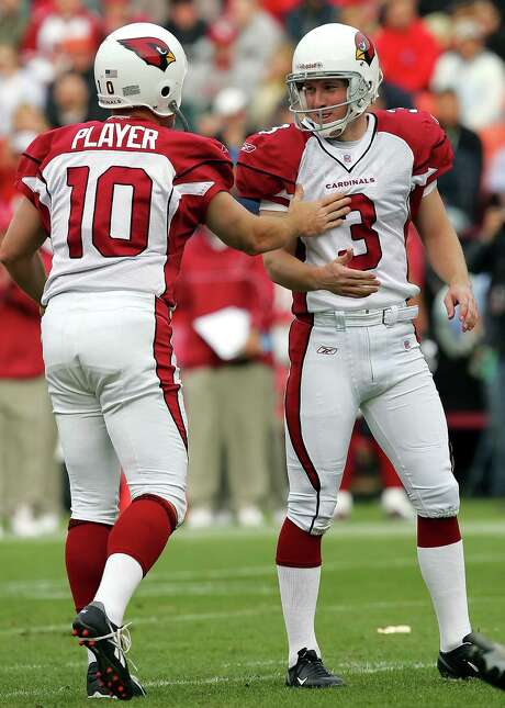 Arizona Cardinals' kicker Nick Novak (3) is congratulated by holder Scott Player (10) after making a 35-yard field goal against the San Francisco 49ers in the third quarter Sunday, Dec. 4, 2005, in San Francisco. Novak made three field goals in the Cardinals' 17-10 win. (AP Photo/Marcio Jose Sanchez) Photo: MARCIO JOSE SANCHEZ, STF / AP