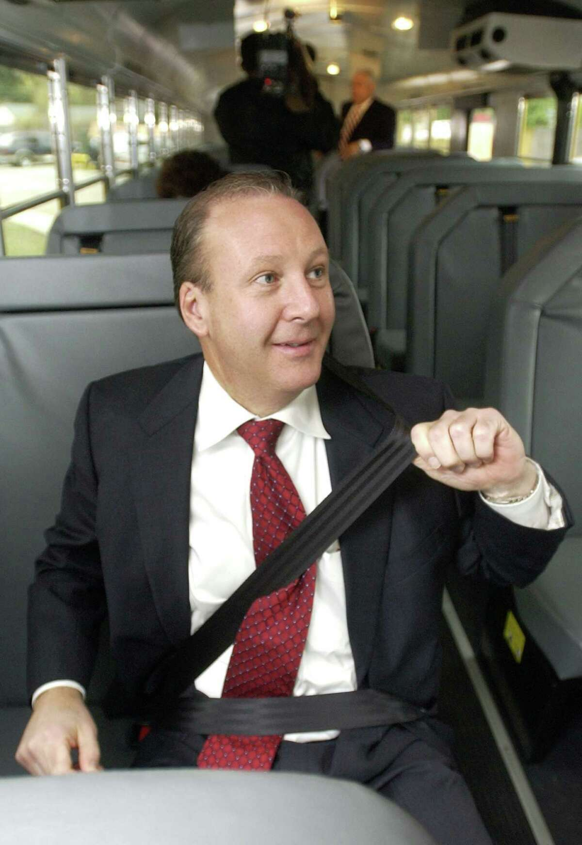 Brad Brown successfully lobbied for seat belts after his daughter was killed in a 2006 bus wreck. He tests out the seat belt on a new school bus in Beaumont.