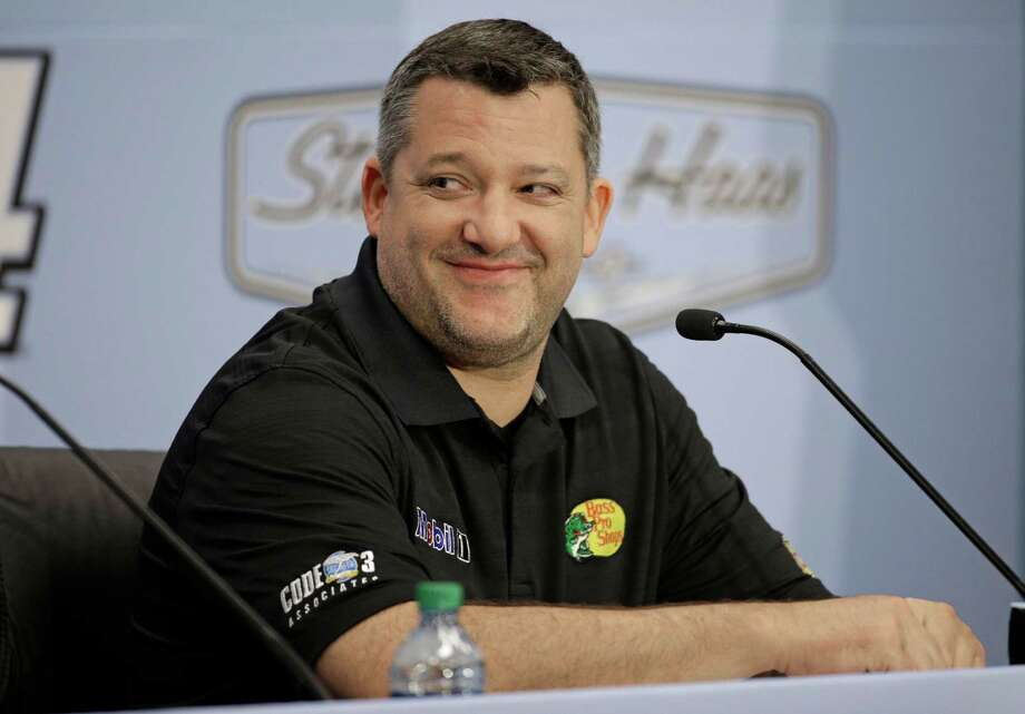 Three-time NASCAR champion Tony Stewart smiles as he announces he will retire after the 2016 season during a news conference at Stewart-Haas Racing's headquarters in Kannapolis, N.C., Wednesday, Sept. 30, 2015. (AP Photo/Chuck Burton) Photo: Chuck Burton, STF / AP