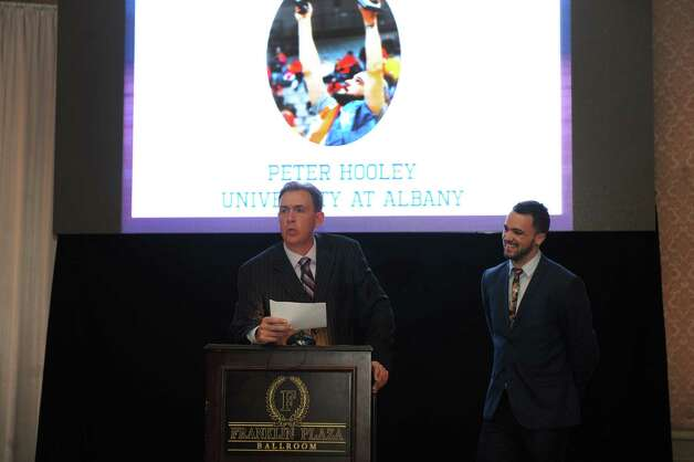UAlbany basketball coach Will Brown, center, introduces fifth year senior guard Peter Hooley being honored with the inspiration award at the annual coaches vs cancer event on Wednesday Sept. 30, 2015 in Troy , N.Y.  (Michael P. Farrell/Times Union) Photo: Michael P. Farrell / 10033555A