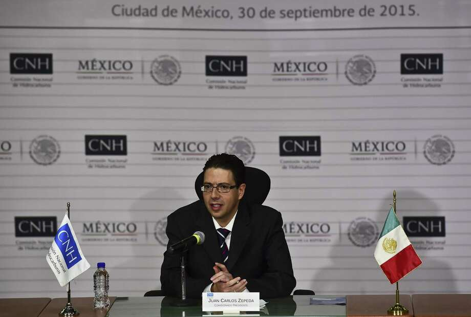 Juan Carlos Zepeda, head of Mexico's National Hydrocarbons Commission, speaks at a news conference after the launch of the second auction's round one. Photo: RONALDO SCHEMIDT, Staff / RONALDO SCHEMIDT