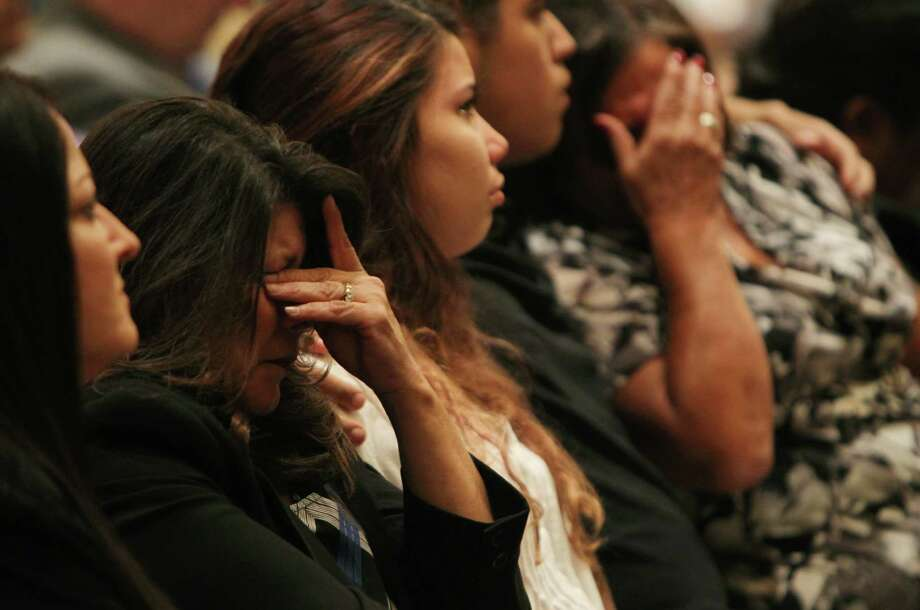 Lanette Soto, whose brothers Gilbert and Robert Tisnado were killed along with two others after inhaling toxic gas in a November 2014 accident at DuPont's La Porte chemical plant, reacts to a video recounting the incident shown at a public meeting by the U.S. Chemical Safety Board at the Hilton Americas hotel in Houston, Wednesday, Sept. 30, 2015. ( Mark Mulligan / Houston Chronicle ) Photo: Mark Mulligan, Staff / © 2015 Houston Chronicle