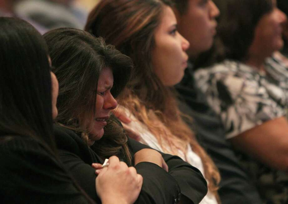 Lanette Soto, whose brothers Gilbert and Robert Tisnado were killed in the DuPont plant accident, reacts as a video of the incident is shown Wednesday at a public meeting of the Chemical Safety Board. Photo: Mark Mulligan, Staff / © 2015 Houston Chronicle