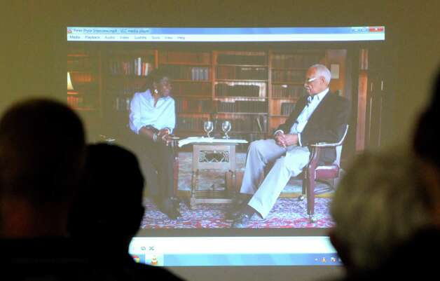 Dr. Alice Green, founder and executive director of the Center for Law and Justice, interviews Peter Pryor,retired civil rights attorney, in a video shown during a community conversation on the history of the black community and police relations in Albany on Wednesday Sept. 30, 2015 in Albany , N.Y.  (Michael P. Farrell/Times Union) Photo: Michael P. Farrell / 10033569A