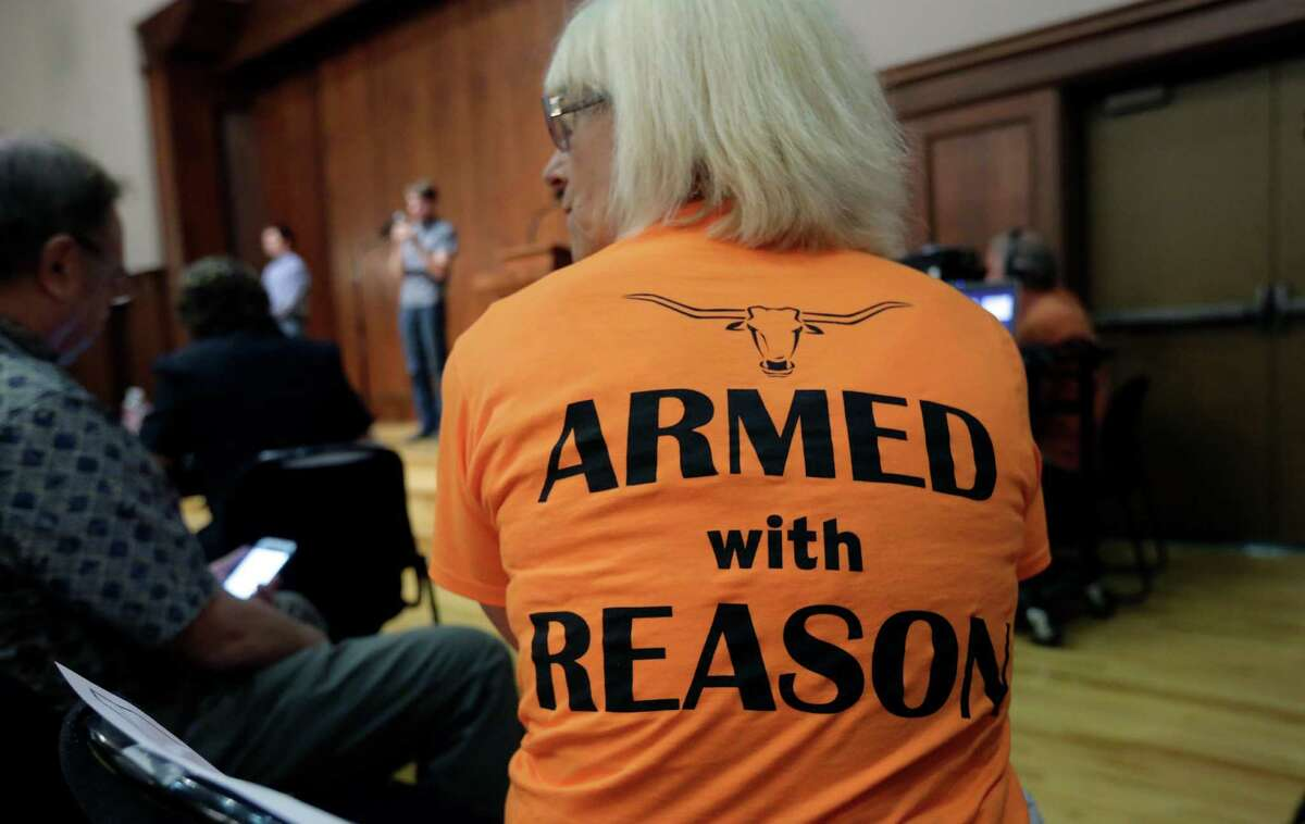 Professor Ann Cvetkovich waits to speak Wednesday during a forum at the University of Texas as a committee studies how to implement a new gun law.