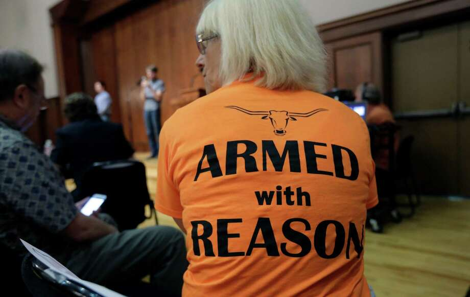 Professor Ann Cvetkovich waits to speak Wednesday during a forum at the University of Texas as a committee studies how to implement a new gun law. Photo: Eric Gay, STF / AP