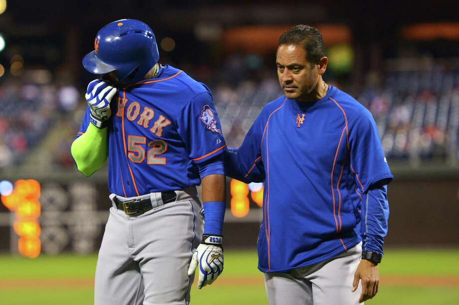 PHILADELPHIA, PA - SEPTEMBER 30: Yoenis Cespedes #52 of the New York Mets is assisted off the field after getting hit by a pitch in the third inning during the game against the Philadelphia Phillies at Citizens Bank Park on September 30, 2015 in Philadelphia, Pennsylvania. (Photo by Drew Hallowell/Getty Images) ORG XMIT: 538596007 Photo: Drew Hallowell / 2015 Getty Images