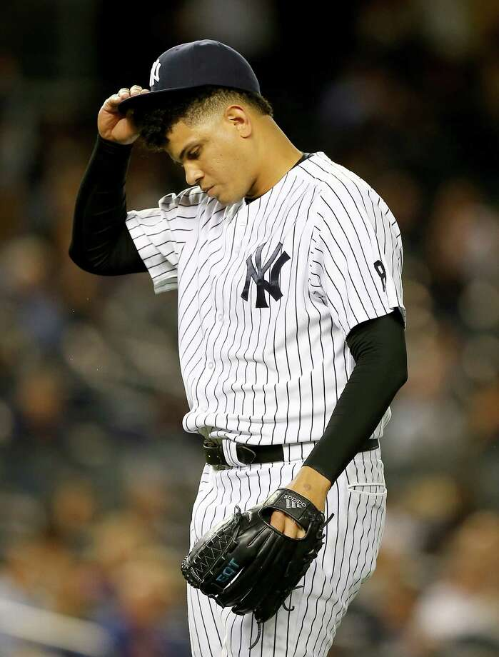 NEW YORK, NY - SEPTEMBER 30:  Dellin Betances #68 of the New York Yankees reacts in the seventh inning against the Boston Red Sox on September 30, 2015 at Yankee Stadium in the Bronx borough of New York City.  (Photo by Elsa/Getty Images) ORG XMIT: 538595977 Photo: Elsa / 2015 Getty Images